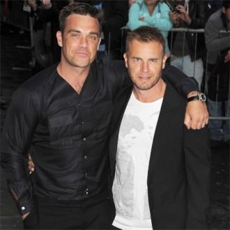 Robbie williams und gary barlow wollen durch einen wettkf abnehmen